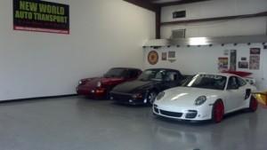Image: Three porsches in a garage.