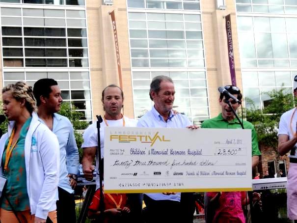 Balboni presents the funds raised for the Children's Memorial Hospital